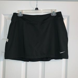 Women's black Nike golf skirt